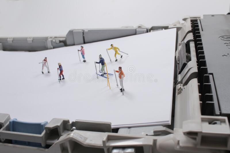 A fun of a figure are skiing on print tray stock images