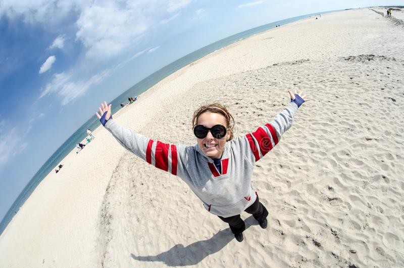 Fun fisheye view of young woman enjoying the beach at Assateague Island Maryland stock images
