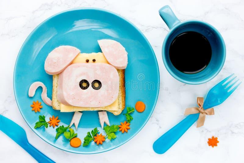 Fun food art idea for kids breakfast - funny pig sandwich stock photography