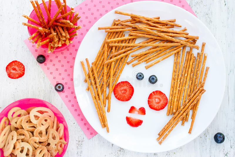 Fun with food concept, breakfast or snack for kids - straw stick. Letti with fresh berries in the form of a cute woman face stock photos