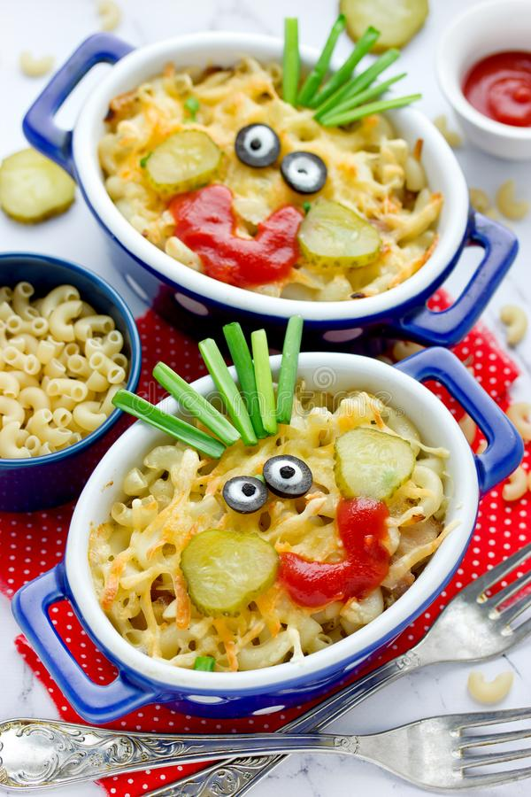 Fun food idea for kids - american mac and cheese pasta baked with cheesy sauce. Fun food idea for kids - american mac and cheese macaroni pasta baked with cheesy stock image
