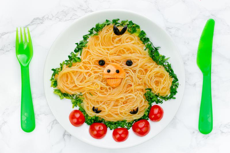 Fun food idea for kids - cute yellow chicken rice noodles stock photography