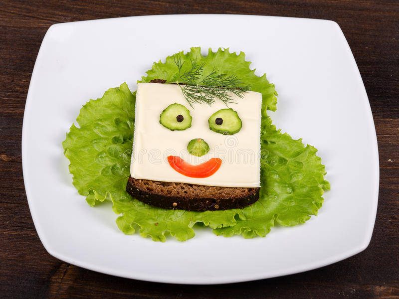 Fun food for kids - face on bread, close up stock photo