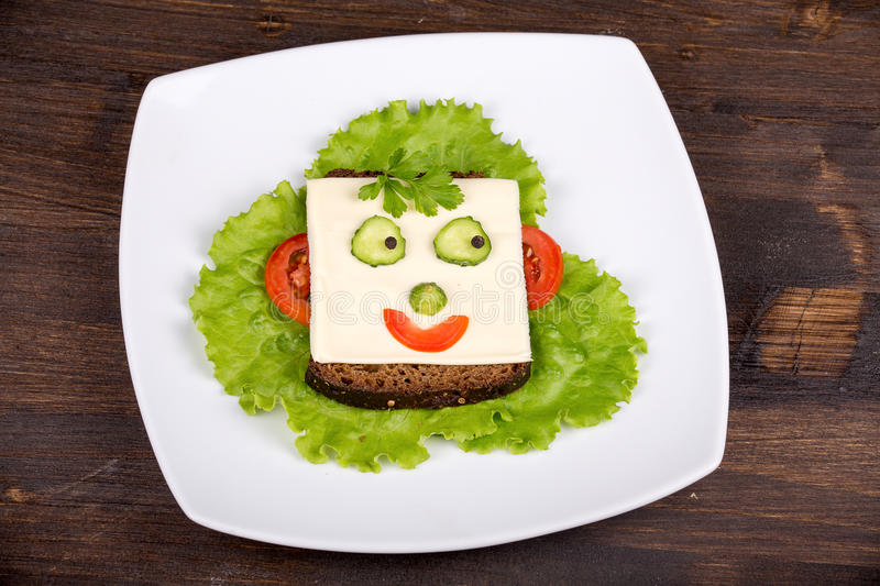 Fun food for kids - face on bread stock photography