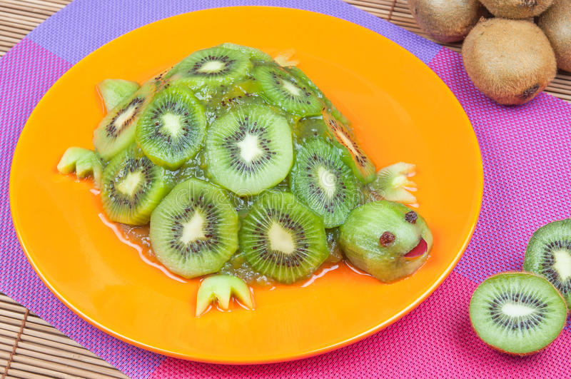 Fun food. Turtle made from kiwi royalty free stock images
