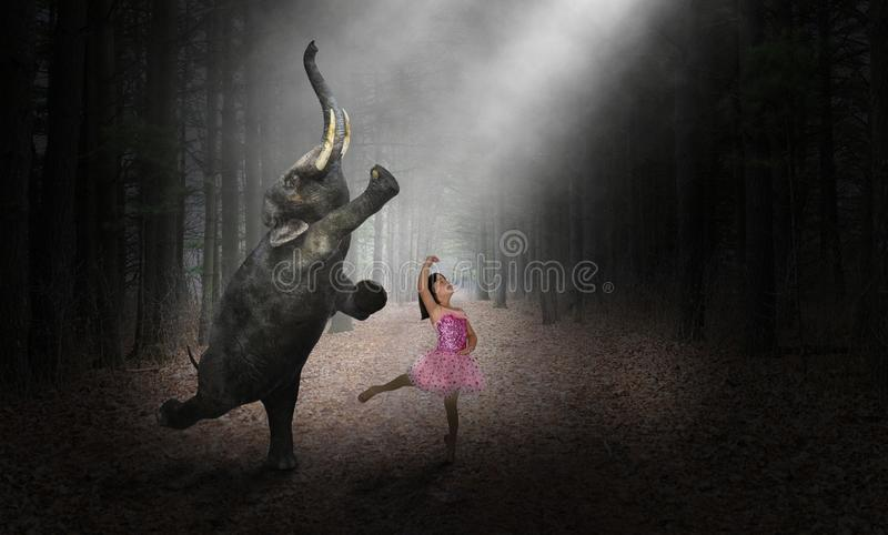 Dancing Elephant, Ballerina Dancer, Girl, Nature. Fun and funny and surreal scene of a young ballerina child dancing with an elephant. The girl uses her