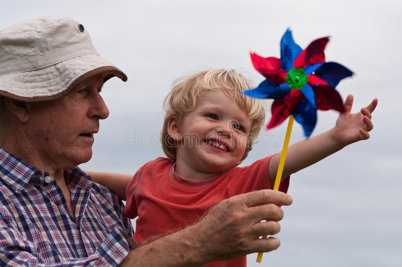 Fun with grandpa. A Grandfather showing his grandson how a windmill works