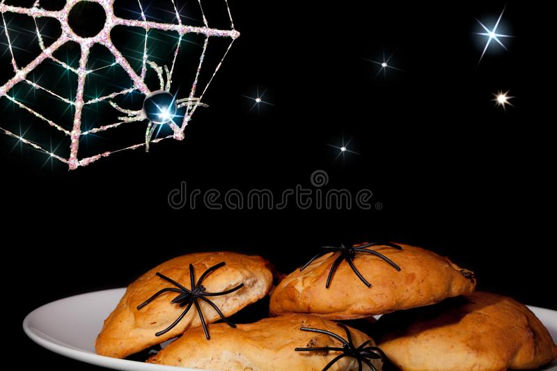 Fun Halloween spider food. Trick or treat party snacks with fantasy cartoon style creepy background. royalty free stock image
