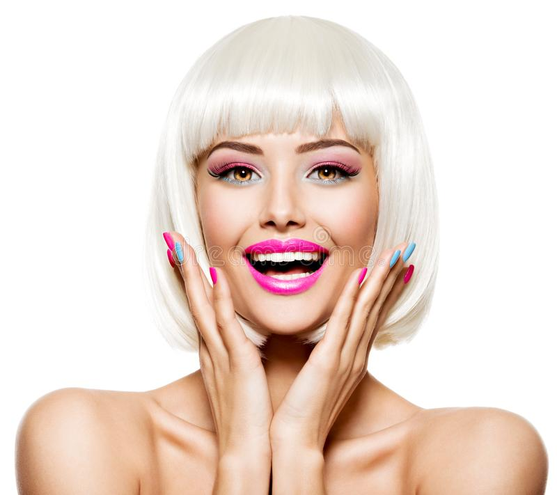 Fun happy face of a pretty woman  with white hairs and multicolor nails. Studio photo stock photography