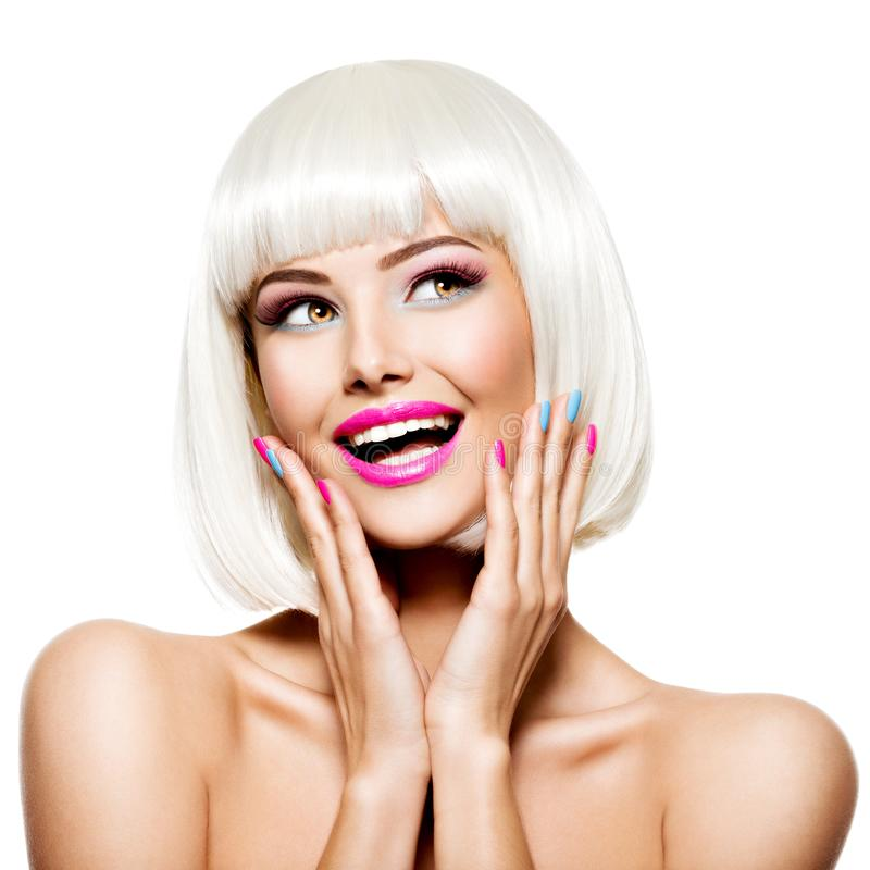Fun happy face of a pretty woman  with white hairs and multicolor nails. Studio photo stock image