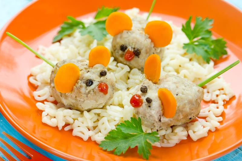 Fun and healthy idea for kids lunch - steamed cutlet shaped mouse. With pasta stock image