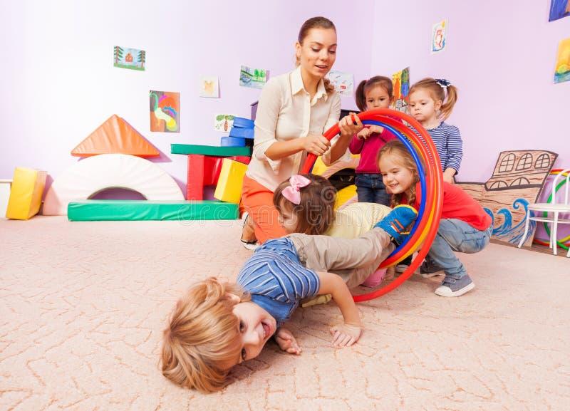 Fun with hoop on the kindergarten class stock images