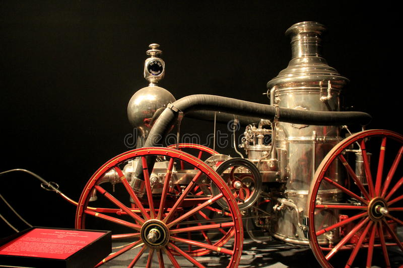 Fun and interesting exhibit of antique Fire Trucks,State Museum,Albany,New York,2016. Interesting exhibit with several antique Fire Trucks, placards posted in royalty free stock images