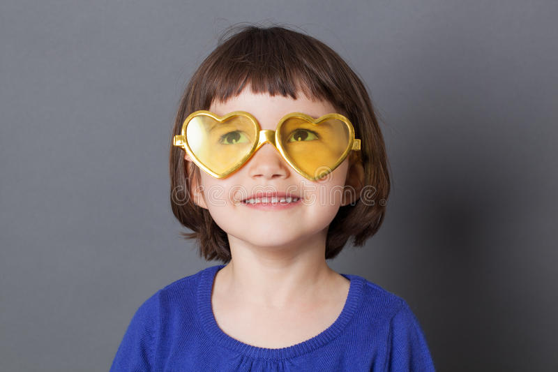 Fun kid glasses concept for daydreaming preschool child royalty free stock photography