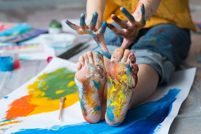 Fun leisure feet hands dirty multicolor paint stock images