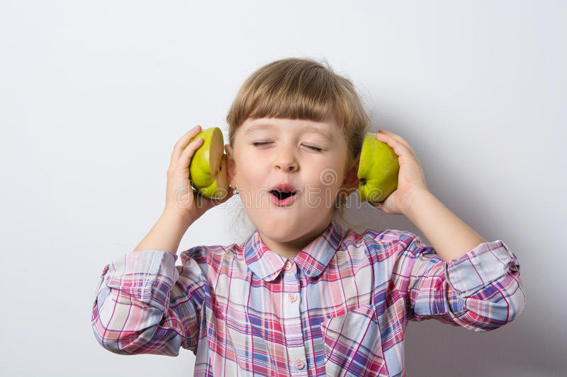Fun little girl listens to music stock photo