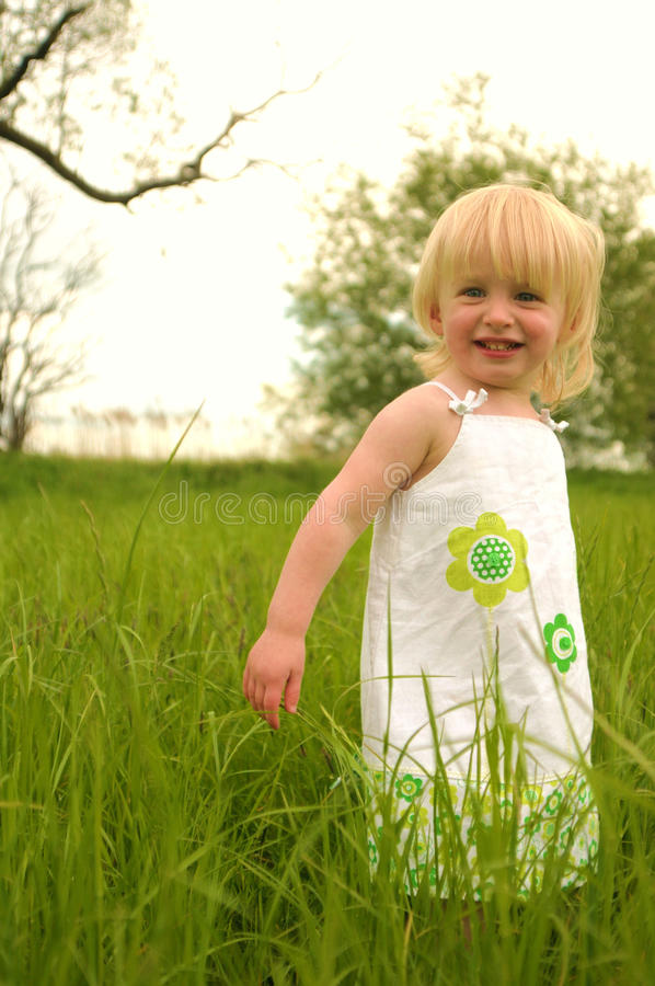 Fun in the long grass stock photos