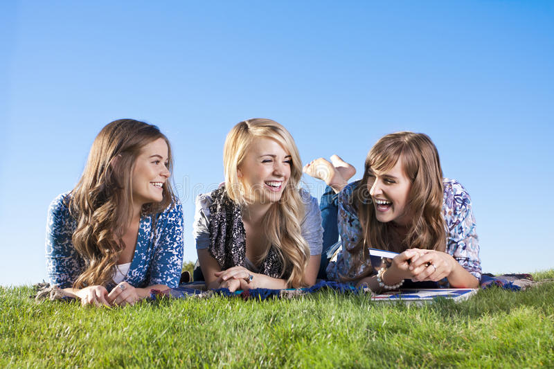 Fun-loving and laughing women. A group of women in their 20s laughing and talking together outdoors stock photography