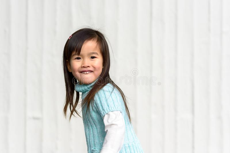 Fun loving playful pretty little Asian girl royalty free stock photography
