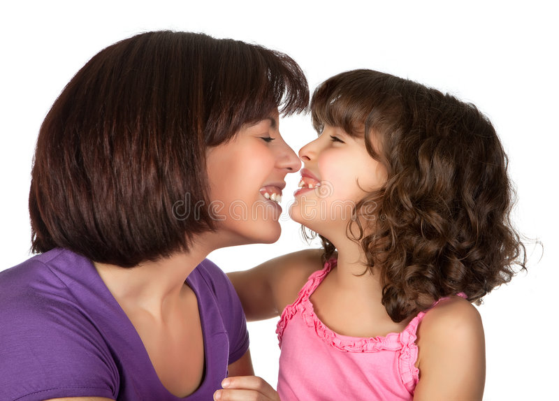 Fun with mommy. Little girl having fun with her beautiful mother stock images