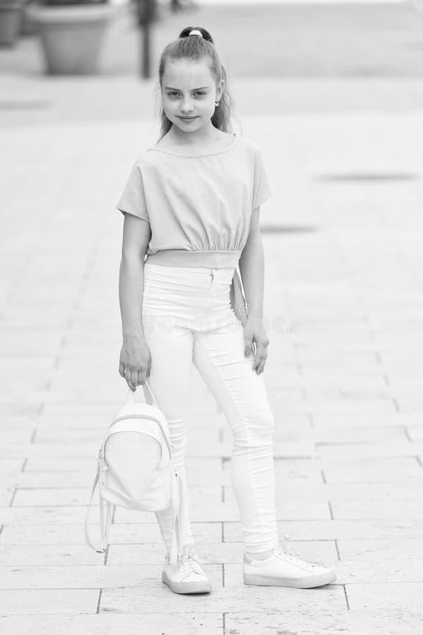 Only fun on my mind. Kid long hair enjoy walk sunny day. Summer holidays. Charming stylish fashionable girl. Little stock photography