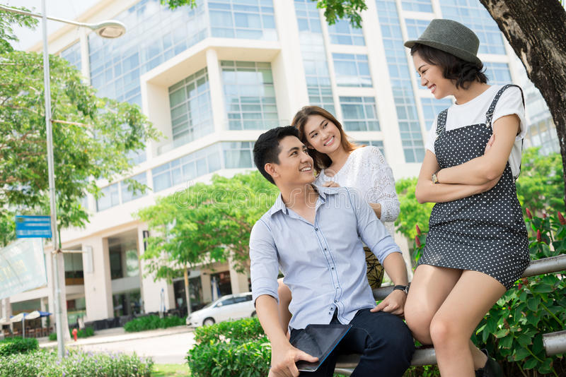 Fun outside. Copy-spaced image of teens talking and smiling outside stock photography
