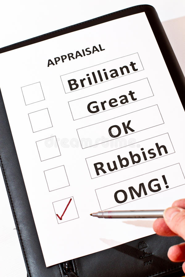 A fun performance appraisal form on black case. A fun performance appraisal form including the category `OMG` [Oh My God royalty free stock photography