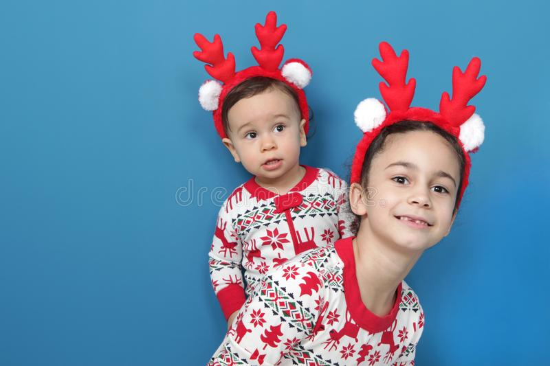 Fun playing children in Christmas pajamas. royalty free stock images