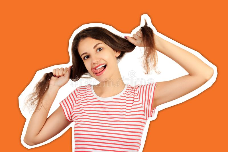 Fun prank joy entertainment concept. Silly girl playing with hairs. emotional girl Magazine collage style with trendy color stock images