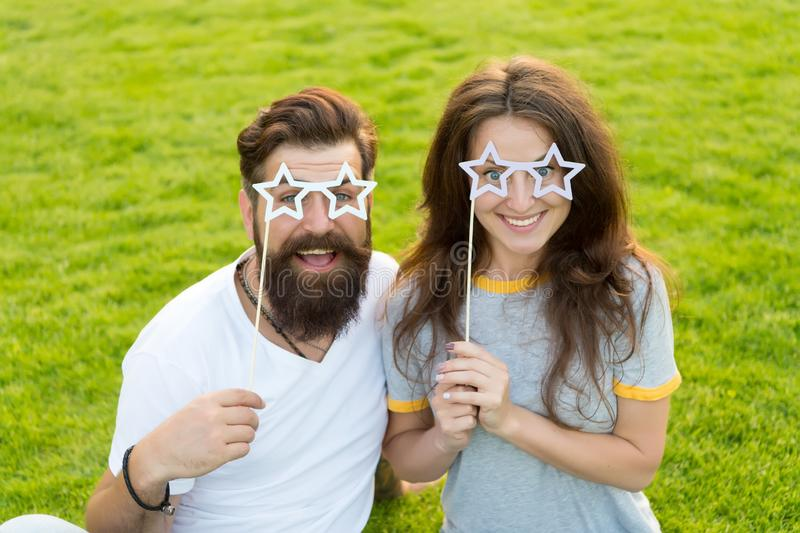 Fun props. Funny couple holding star-shaped photobooth props on sticks. Happy family celebrating with party props royalty free stock photos