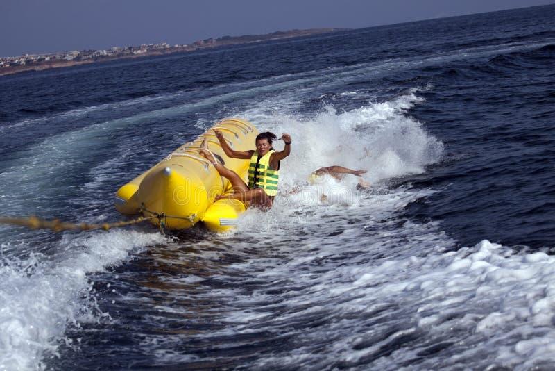 Fun riding banana boat. royalty free stock photos