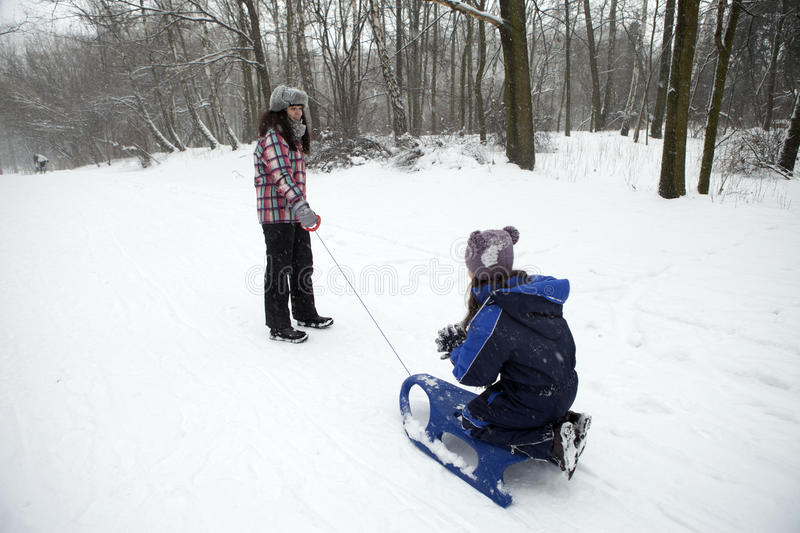 Fun in the snow. We go on a sled royalty free stock image
