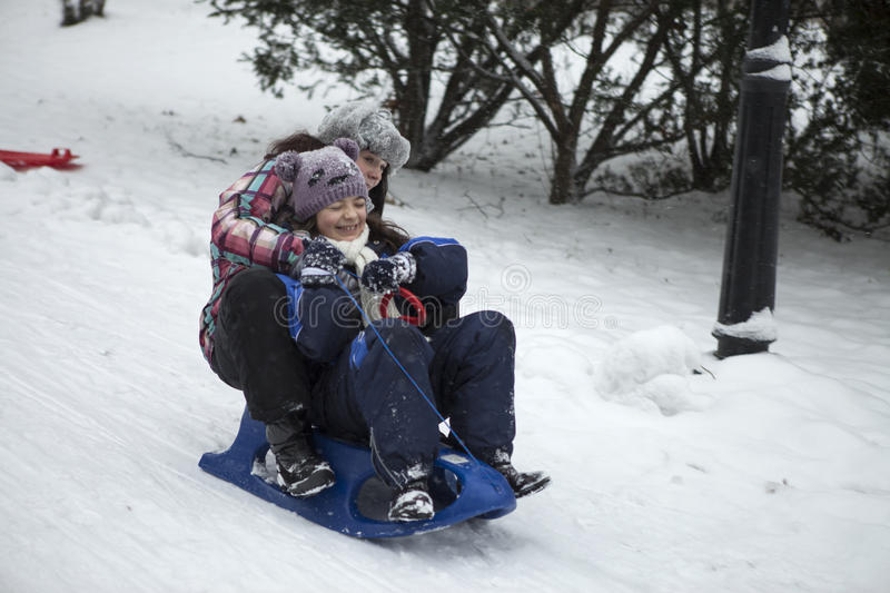 Fun in the snow. We go on a sled royalty free stock photos