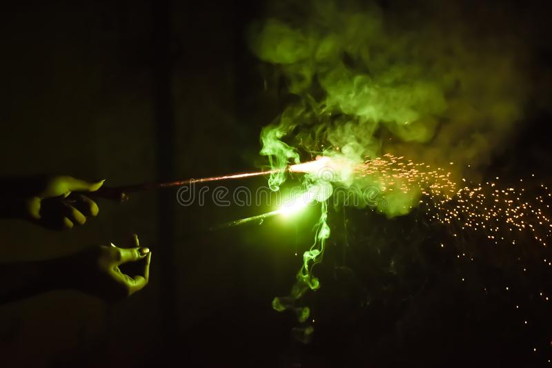 Fun with sparkler. Lady holding fire-sticks royalty free stock image