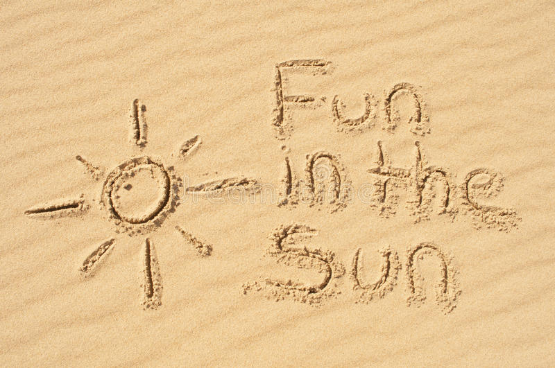 Fun in the Sun written in the Sand royalty free stock photo