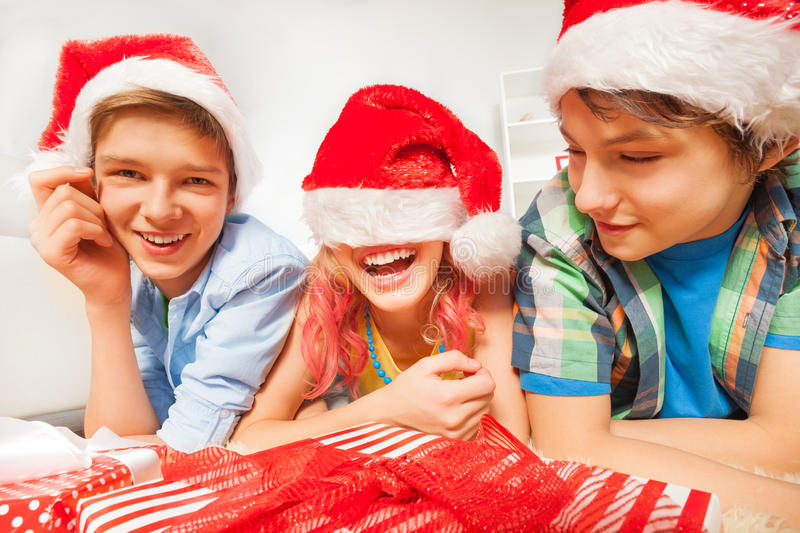 Fun for teens on New year party with Santa hats stock image