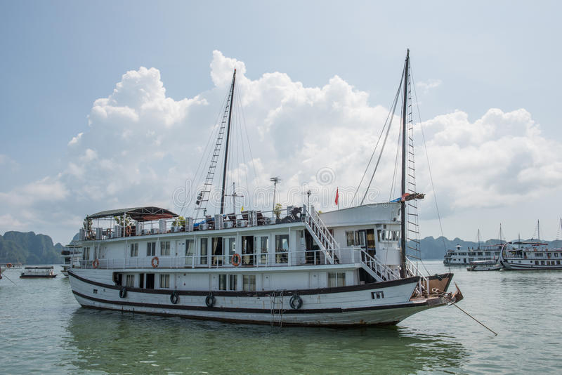 Fun on Tourist Boat. A decorated tourist boat sailing on Ha Long Bay, Vietnam. Boat riding in Ha Long is magnificent and take you across jaw-dropping karst royalty free stock image