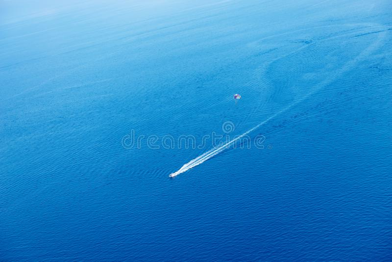 Water sports, jet ski and parasailing in the sea. Aerial view. Fun at the vacation. Water sports, jet ski and parasailing in the blue sea. Aerial view royalty free stock photos
