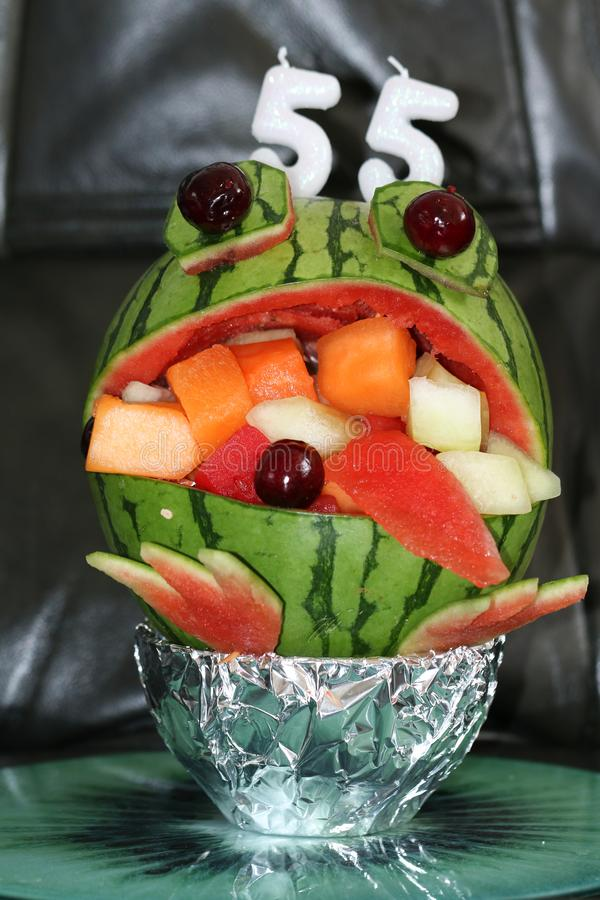 A watermelon frog Birthday Cake filled with exotic fruits. royalty free stock photography