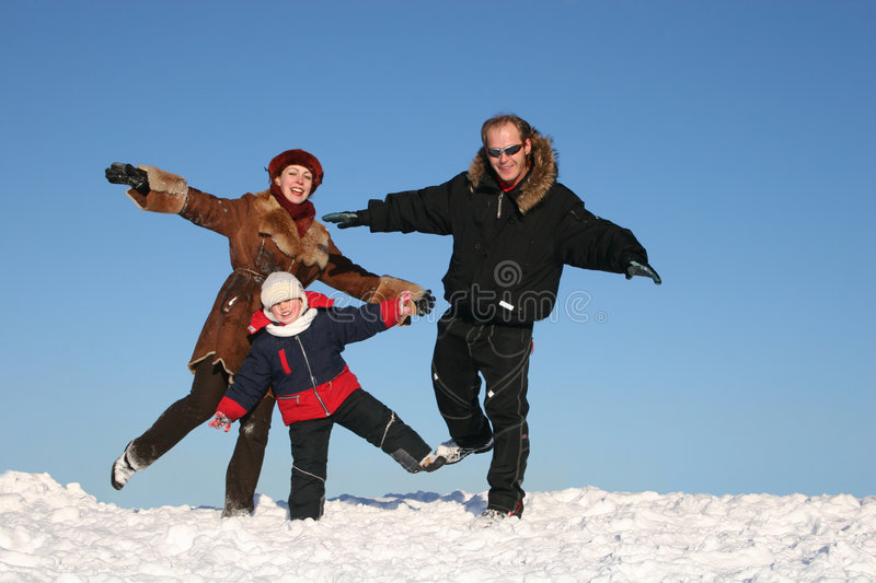 Fun winter family stock images