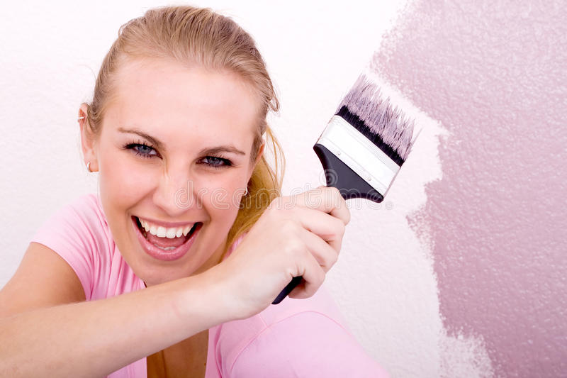 Fun woman painting royalty free stock images