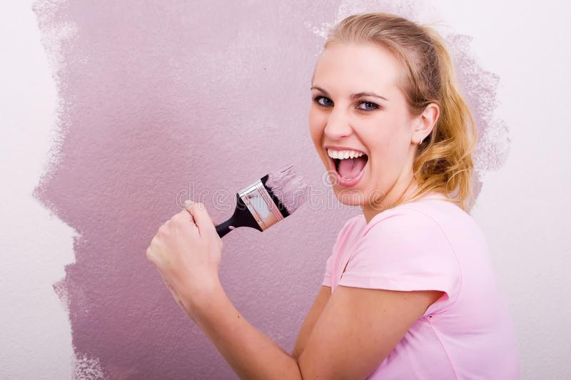 Fun woman painting royalty free stock image