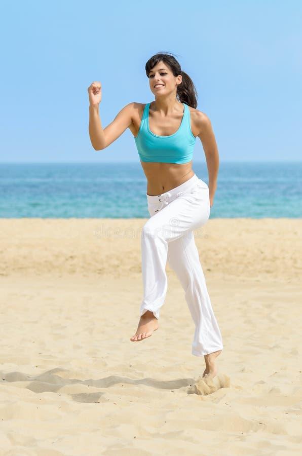 Fun Woman Running Jumping On Beach Stock Photo