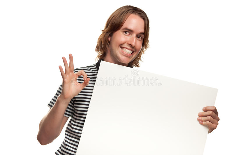 Fun Young Man Holding Blank White Sign royalty free stock photos