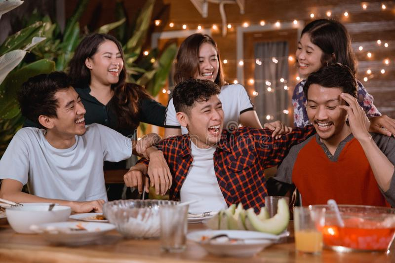 Fun young people laughing while having garden party at home stock photos