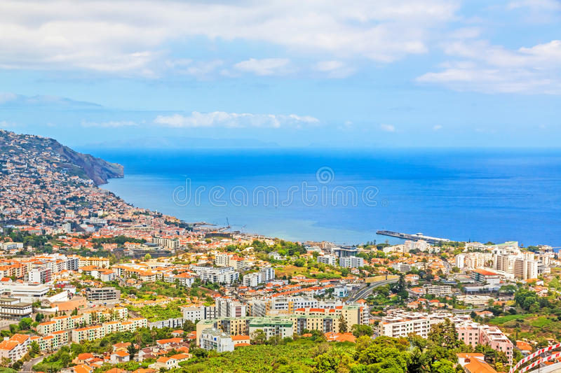 Funchal, Madeira. June 7, 2013: South coast of Funchal -view over the capital city of Madeira towards harbor. View from Pico dos Barcelo - Atlantic Ocean in stock photography