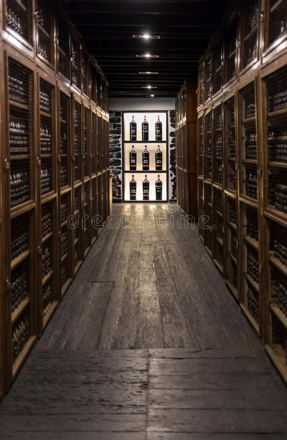 Museum - repository of expensive vintage wine Madera. Long rows of shelves made of bottles of wine. funchal, Madera. Portugal. Funchal, Madeira, Portugal - April stock photo