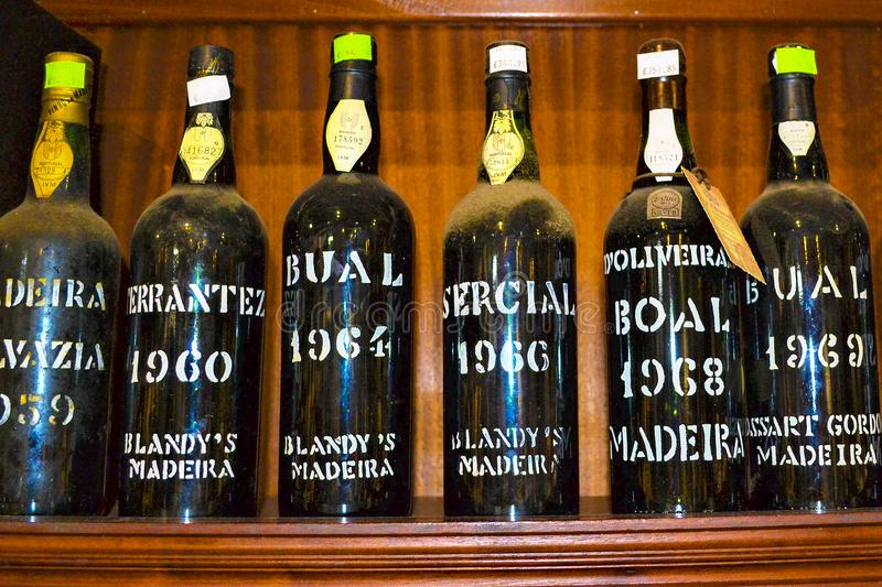 FUNCHAL, MADEIRA / PORTUGAL - FEBRUARY 2017: MADEIRA WINE BOTTLES. VINTAGE MADEIRA WINE BOTTLES IN FUNCHAL STORE stock photos