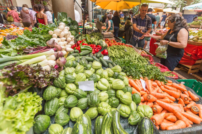 FUNCHAL, MADEIRA, PORTUGAL - JUNE 29, 2015: Bustling fruit and vegetable market in Funchal Madeira on June 29, 2015. stock photos