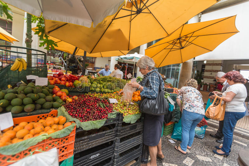 FUNCHAL, MADEIRA, PORTUGAL - JUNE 29, 2015: Bustling fruit and vegetable market in Funchal Madeira on June 29, 2015. stock images